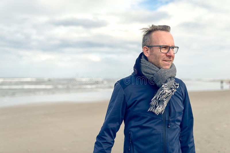 Irritated middle-aged man on an autumn beach stock images