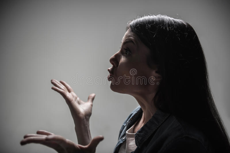 Irritated wife using gesticulation. My mistake. Angry brunette keeping her eyes widely opened while expressing astonishment while standing in semi position stock photography