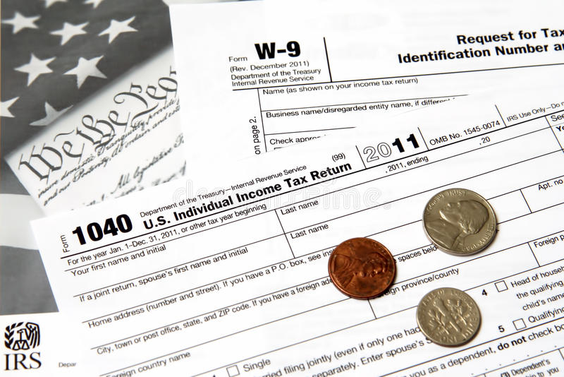 IRS 1040 from. IRS tax forms are used for taxpayers and tax-exempt organizations to report financial information to the Internal Revenue Service (IRS) of the royalty free stock photo
