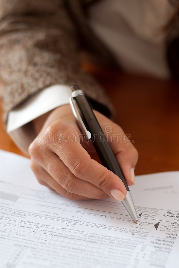 Irs. A woman filling the irs forms royalty free stock images