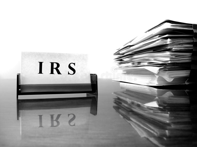 IRS Card with Tax Files. IRS Card on desck with tax files stock photos
