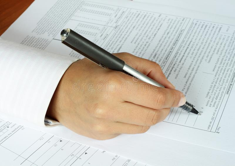 IRS Form. A woman hand filling the IRS form stock photo