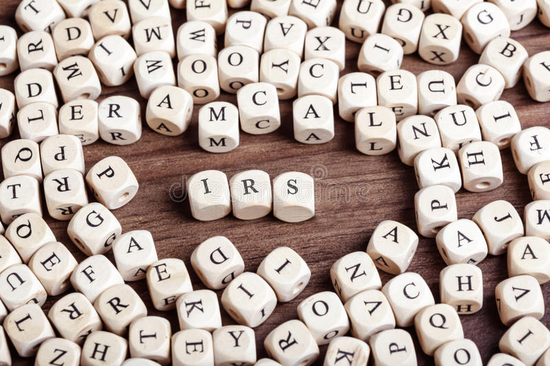IRS, letter dices word. Word IRS in letters on cube dices on table stock photos