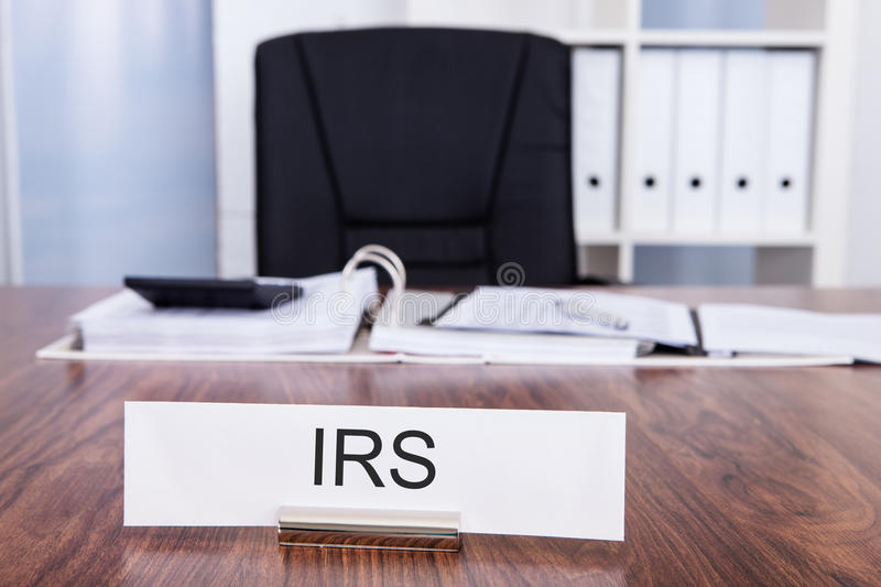 Irs nameplate in office. Office Desk And Chair With Irs Nameplate stock photo