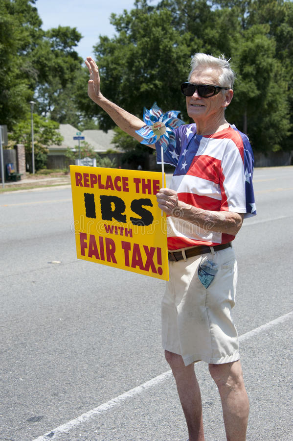IRS Protest. PENSACOLA, FL - 21 MAY: Protesters rally in front of local IRS office in Pnesacola, FL on May 21, 2013 in response to news that conservative groups royalty free stock photo