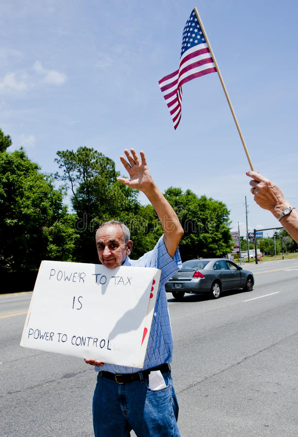 IRS Protest. PENSACOLA, FL - 21 MAY: Protesters rally in front of local IRS office in Pnesacola, FL on May 21, 2013 in response to news that conservative groups royalty free stock photos