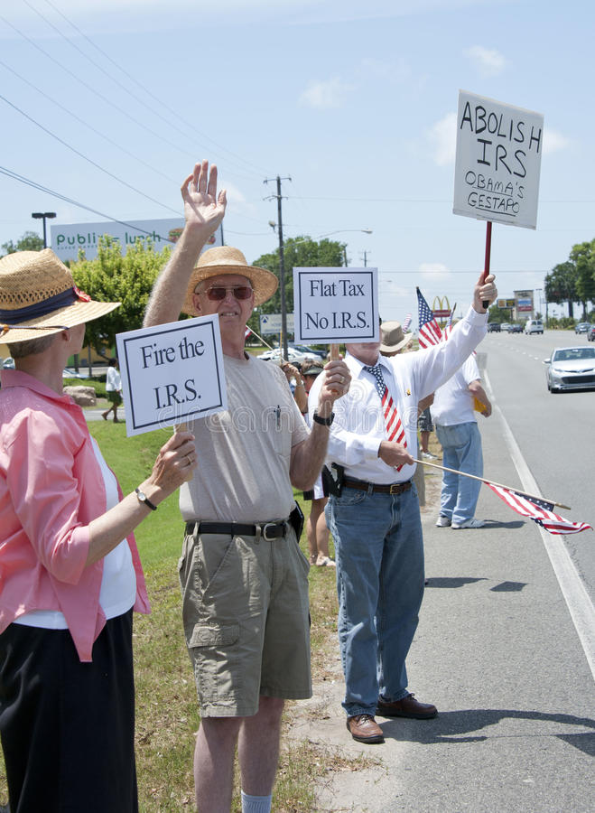 IRS Protest. Protesters rally in front of IRS office to express outrage over conservative group harrassment stock images