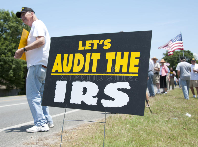 IRS Protest. Protesters rally in front of IRS office to express outrage over conservative group harrassment royalty free stock image
