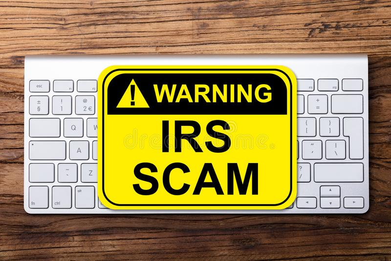 IRS Scam Warning Sign On Keyboard royalty free stock photography