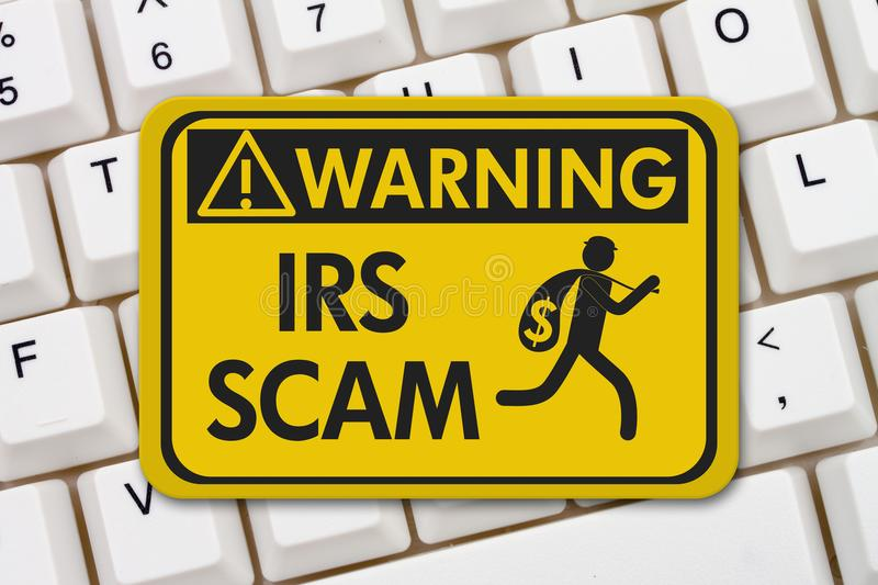 IRS scam warning sign with keyboard stock photography