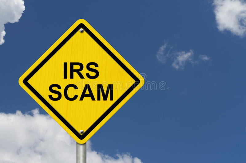 IRS Scam Warning Sign. Yellow warning road sign with word IRS Scam with sky background stock photo
