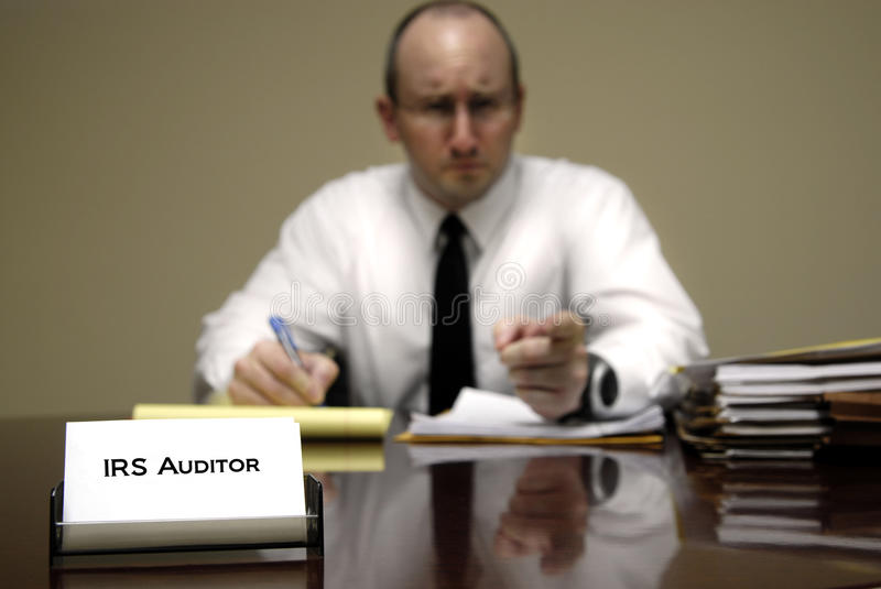 IRS Tax Auditor. Man with a stern or mean expression stock photo