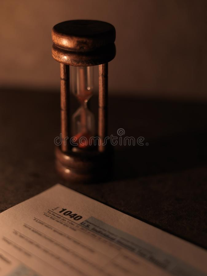 IRS 1040 Tax Form With Hourglass. Time running out to file royalty free stock photography