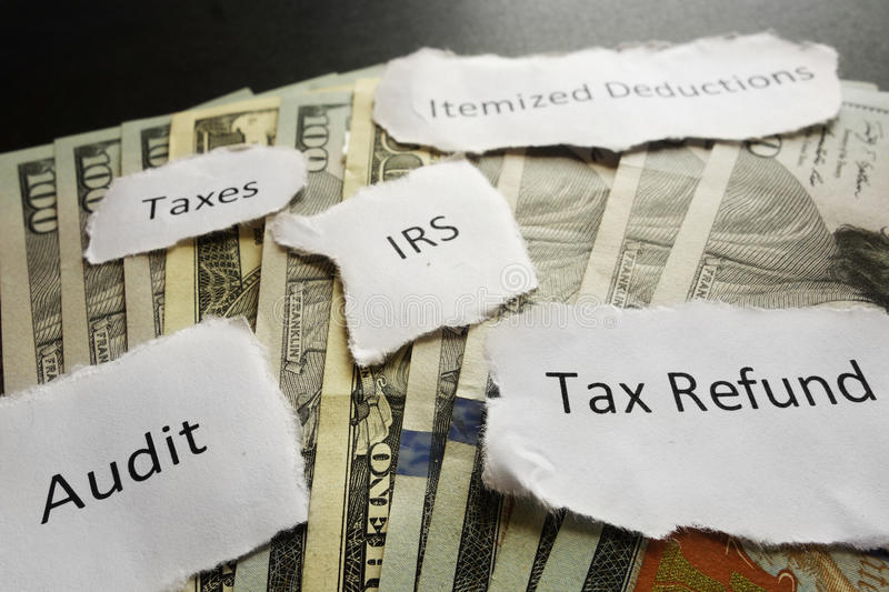 IRS tax notes. IRS tax related paper notes on cash royalty free stock photography