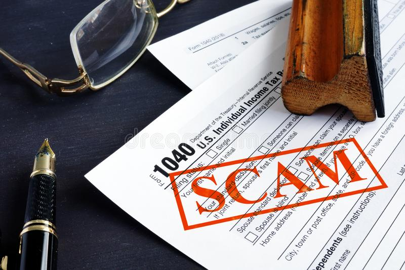 IRS tax scam. 1040 form and red stamp. IRS tax scam concept. 1040 form and red stamp stock photos