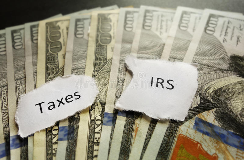 IRS and Taxes. Taxes and IRS paper notes on money stock photo