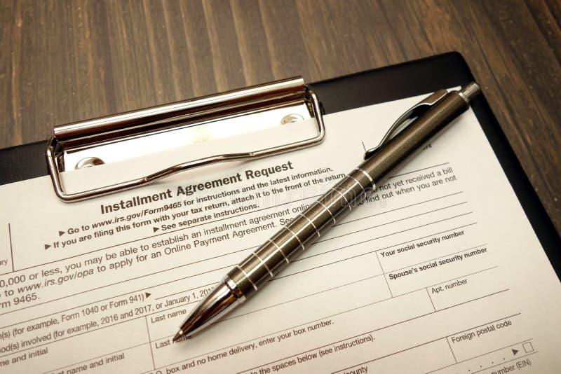 IRS U S formulário do pedido do acordo da prestação com pena foto de stock royalty free