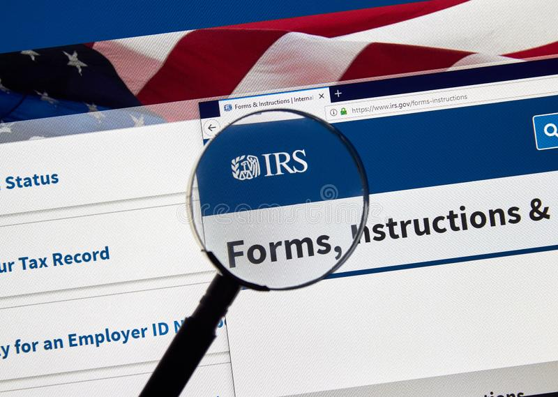 IRS USA Government home page. MONTREAL, CANADA - APRIL 24, 2019 : IRS Forms and Instructions USA Government home page under magnifying glass. IRS.com is an royalty free stock image
