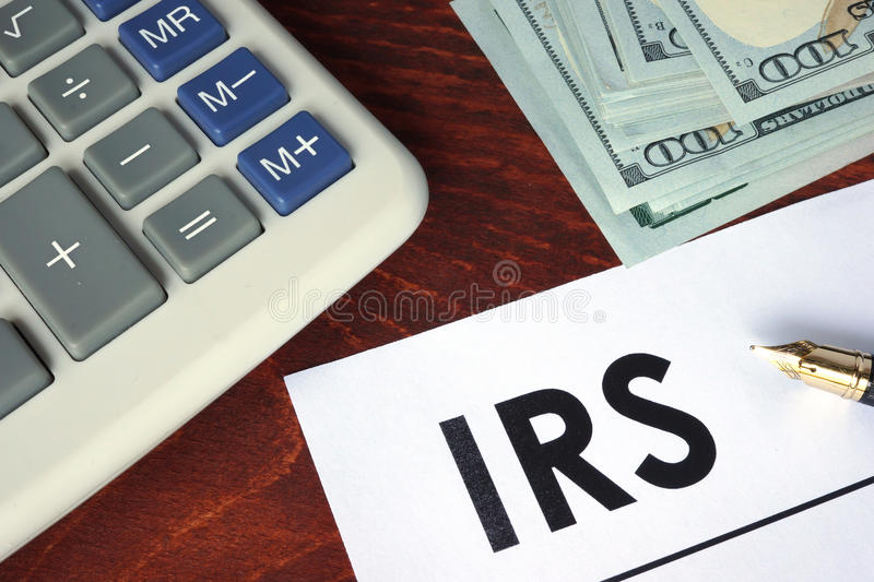 IRS written on a paper. Financial concept stock images
