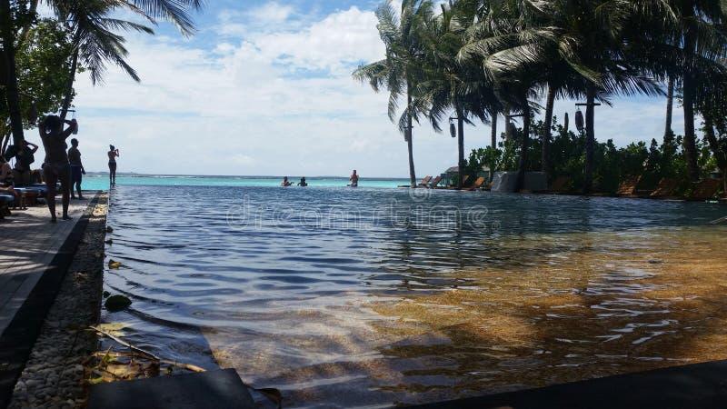 Irufushi de Sião do sol de Maldivas fotos de stock royalty free