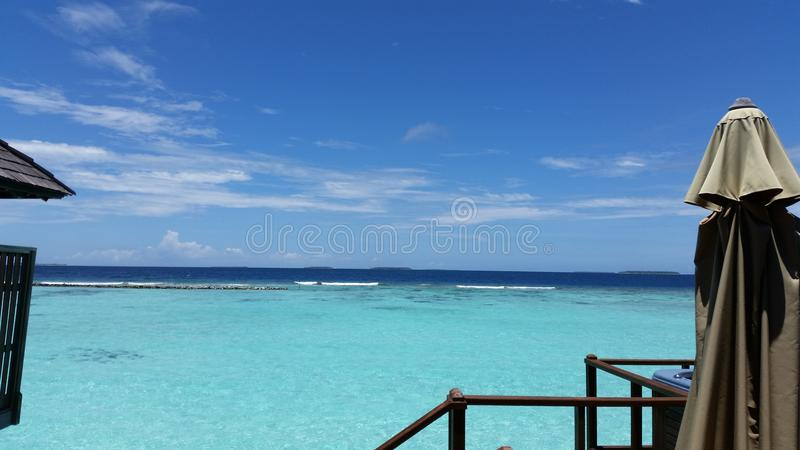 Irufushi de Sião do sol de Maldivas imagem de stock