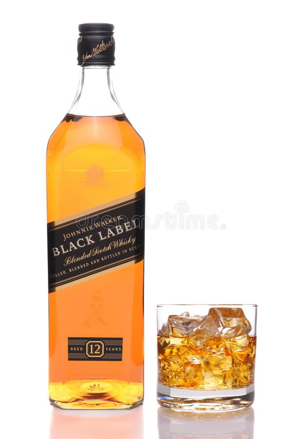 IRVINE, CALIFORNIA - JULY 10, 2017: A bottle of Johnnie Walker Black Label and glass on the rocks stock images