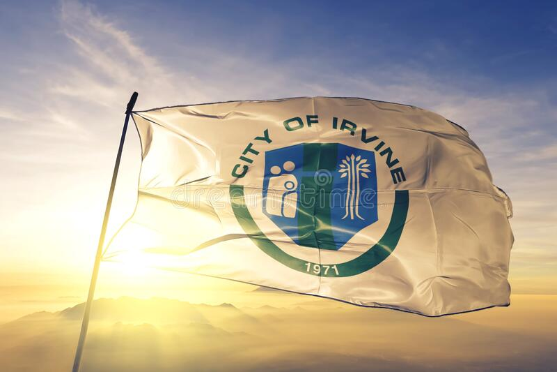 Irvine of California of United States flag waving on the top. Irvine of California of United States flag waving stock photos