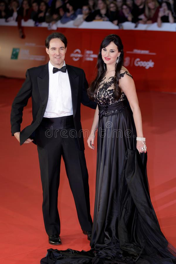 Isabelle Adriani and Vittorio palazzi walks a Red Carpet - 12th. ROME, ITALY - OCTOBER 28: Isabelle Adriani and Vittorio Palazzi walk a red carpet for `Stronger royalty free stock images