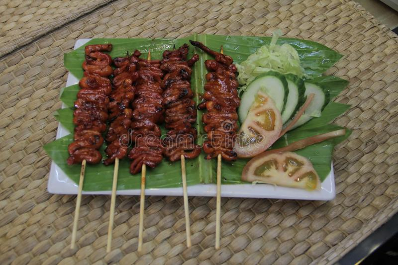 Isaw ng Manok Grilled Chicken Intestine. Also known as Barbecue isaw, grilled chicken intestine is a mainstay in the side-streets of Metro Manila. This food has royalty free stock photo