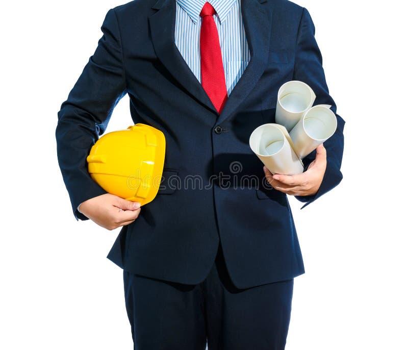 Iscensätta den gula hjälmen för arbetarsäkerhet med konstruktion pl royaltyfri bild