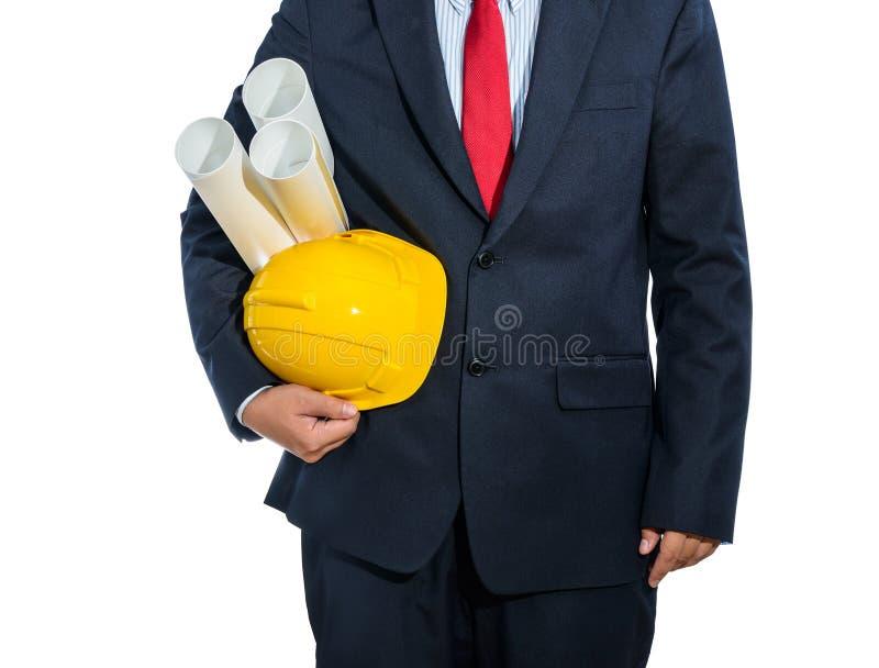 Iscensätta den gula hjälmen för arbetarsäkerhet med konstruktion pl royaltyfri foto