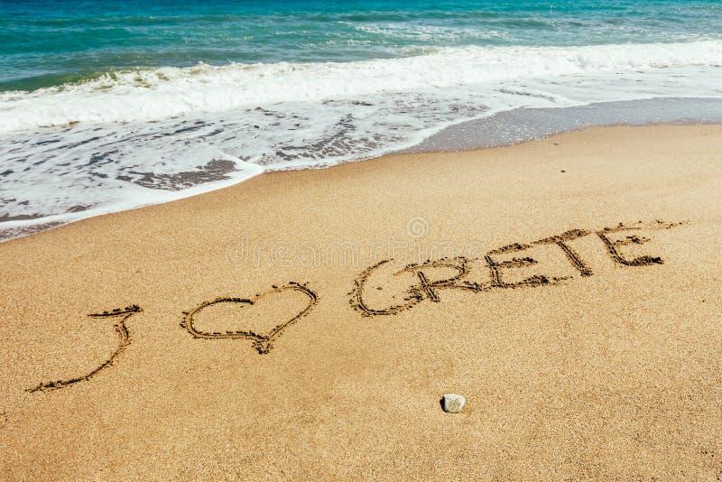 Iscrizione di Creta sulla sabbia immagini stock