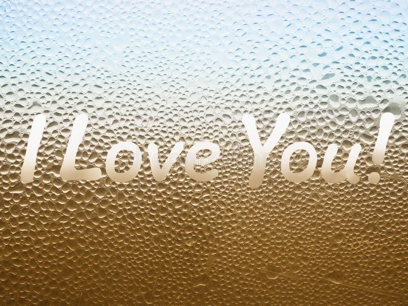 Iscrizione ti amo! sul vetro sudato fotografie stock libere da diritti