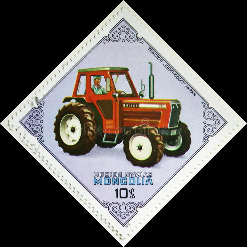 Iseki-6500 Tractor, Japan, Tractors serie, circa 1982. MOSCOW, RUSSIA - AUGUST 4, 2019: Postage stamp printed in Mongolia shows Iseki-6500 Tractor, Japan royalty free stock photo