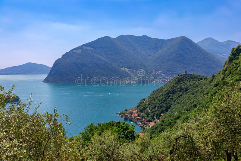 Beautiful view of Lake Iseo with a small old town on the shore and a medieval castle on. The hill. Brescia, Lombardy, Italy stock photo