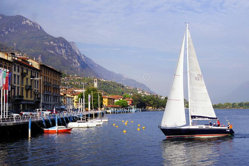 ISEO LAKE, ITALY, 20 OCTOBER, 2018: Yachting on Iseo Lake, near to Lovere town. Lago d`Iseo or Sebino is the fourth largest lake in Lombardy, Italy, fed by the stock images