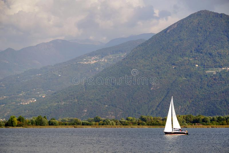 ISEO LAKE, ITALY, 20 OCTOBER, 2018: Yachting on Iseo Lake, near to Lovere town. Lago d`Iseo or Sebino is the fourth largest lake in Lombardy, Italy, fed by the royalty free stock photo