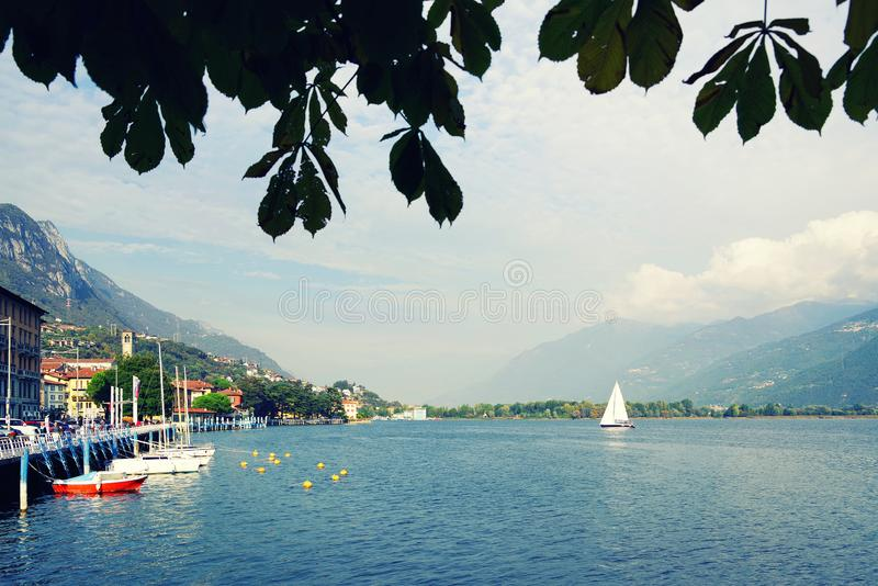 ISEO LAKE, ITALY, 20 OCTOBER, 2018: Yachting on Iseo Lake, near to Lovere town. Lago d`Iseo or Sebino is the fourth largest lake in Lombardy, Italy, fed by the stock image