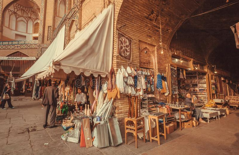Marketplace with sellers of good, stuff in walls of building of Eastern Bazaar. ISFAHAN, IRAN - OCT 14: Marketplace with sellers of good, stuff in walls of royalty free stock image