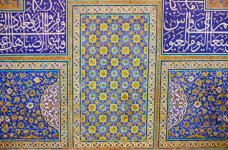 The tiling in Sheikh Lotfollah Mosque, Isfahan, Iran. ISFAHAN, IRAN - OCTOBER 21, 2017: Details of wall in Sheikh Lotfollah mosque, with ornamental panels and royalty free stock photos