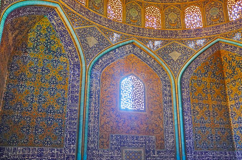 The wall decors of Sheikh Lotfollah Mosque, Isfahan, Iran. ISFAHAN, IRAN - OCTOBER 21, 2017: Interior of Sheikh Lotfollah mosque with rich Islamic patterns on stock photography