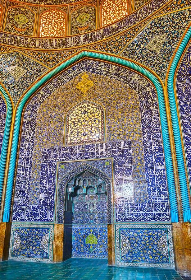 Visit Sheikh Lotfollah Mosque, Isfahan, Iran. ISFAHAN, IRAN - OCTOBER 21, 2017: The scenic mihrab of royal Sheikh Lotfollah mosque, the Qibla niche surrounded by royalty free stock photography
