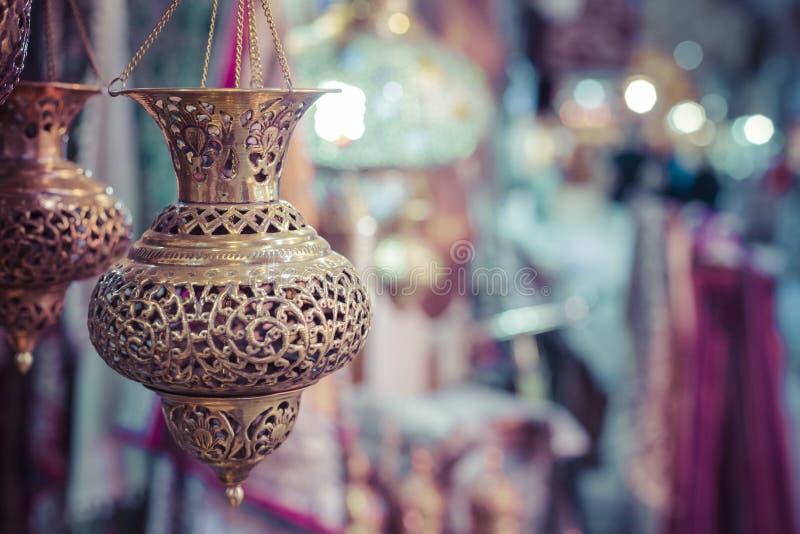 ISFAHAN, IRAN - OCTOBER 06, 2016: Traditional iranian market Ba. Zaar metal souvenires, lamps royalty free stock images