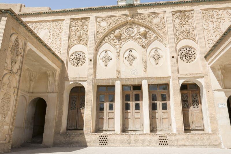 Isfahan Province- Kashan  IRAN-April 30- 2019 wooden windows and wall carving inside Borujerdi house royalty free stock image