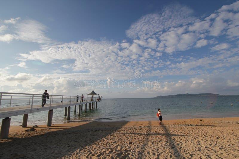 Sea, sky, cloud, beach, horizon, body, of, water, ocean, pier, shore, coast, sand, coastal, and, oceanic, landforms, vacation, wav. Photo of sea, sky, cloud stock images