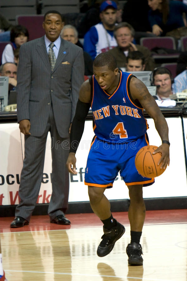 Isiah Thomas Watches Nate Robinson stock foto's