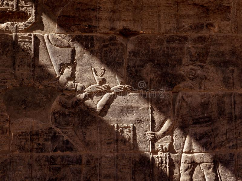 Isis Goddess and Horus hyeroglyphs in Philae Temple in Aswna Egypt. Isis Goddess and Horus hieroglyphs in Philae Temple in Aswna Egypt. Egyptian civilization royalty free stock images