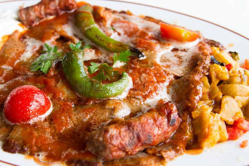 Iskender Kebab. Close up view of Turkish iskender kebab, doner with tomatoes and peppers stock images