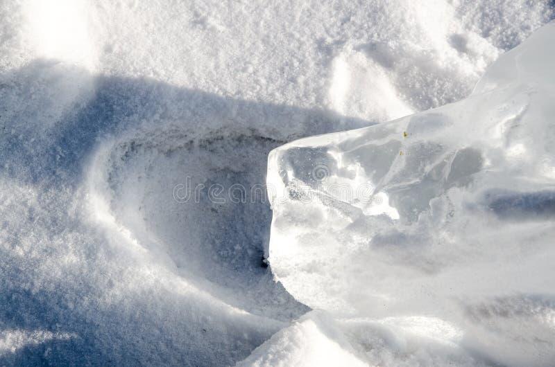 Iskub och snö royaltyfri foto