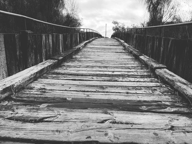 Isla Cristina`s wooden boardwalk black and white. Wooden boardwalk Isla Cristina province of Huelva, Spain royalty free stock photos